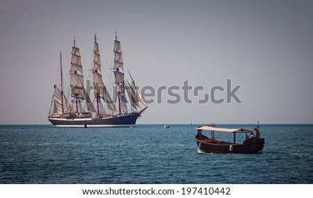 Sailing ship and boat in the sea - stock photo