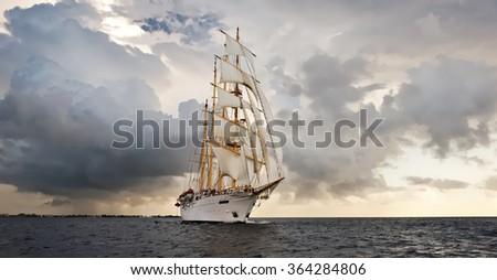 Sailing ship and the stormy sky. Sail. Yachting. Sailing - stock photo