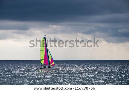 Sailing ship at sea on a cloudy day - stock photo