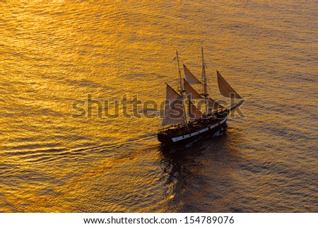 Sailing ship in the evening - stock photo