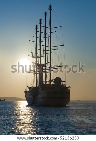 Sailing ship in the sea at sunset