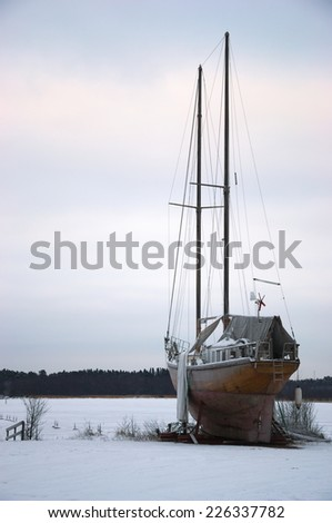 Sailing ship on shore in winter