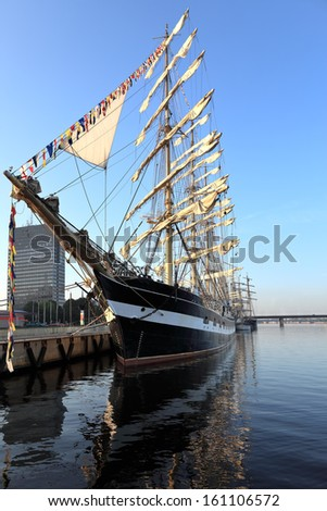 Sailing ship standing at the pier in the early morning, Riga (Latvia) - stock photo