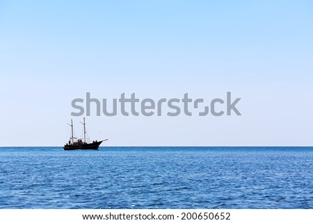 sailing ship the high seas on the horizon in good weather on a background of blue sky. marine background. marine tourism - stock photo