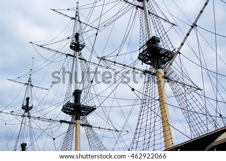 Sailing ship with tall masts against a blue sky
