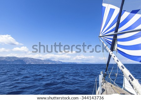 Sailing ship yachts with blue white sails in the Sea. Luxury boats.  - stock photo
