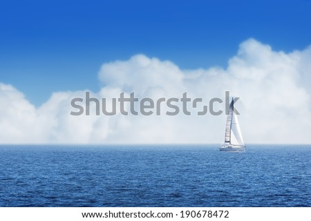 Sailing ship yachts with white sails, cloudy sky - stock photo