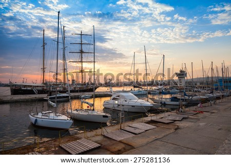 Sailing ships and yachts stand moored in Varna port at the sunset. Black Sea coast, Bulgaria - stock photo