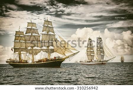 Sailing ships under sail. Toned image and blur. Retro style postcard. Sailing. Yachting. - stock photo