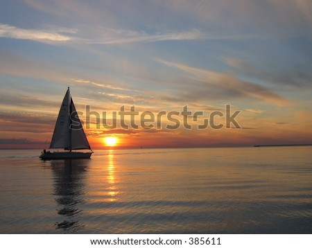 Sailing sunset - stock photo