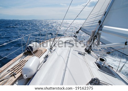 Sailing toward sun on a late winter day - stock photo
