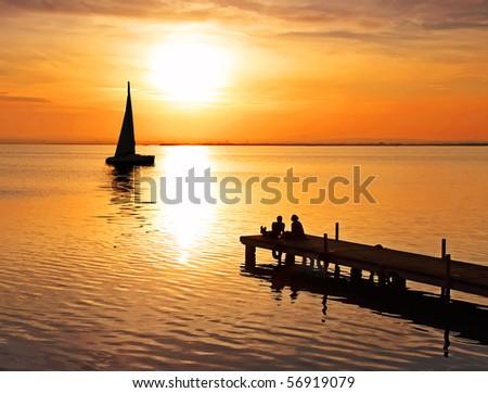 sailing towards the sun - stock photo