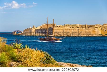 Sailing vassel passing Marsamxett Harbour in Malta - stock photo