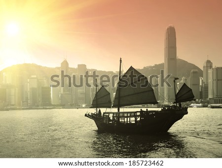 Sailing Victoria Harbor at skyline in Hong Kong  - stock photo