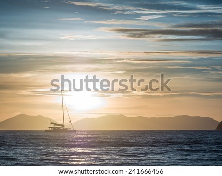 Sailing yacht at sunset in Thailand - stock photo