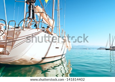 sailing yacht docked in the marina in the background horizon - stock photo