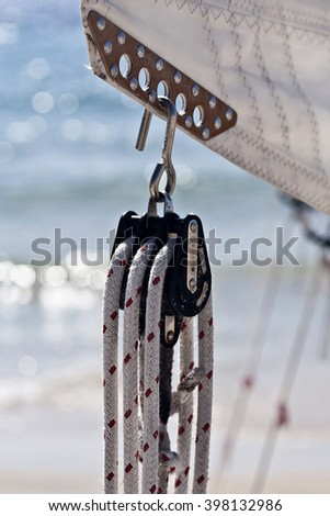 Sailing yacht equipment: block with red and white line - stock photo