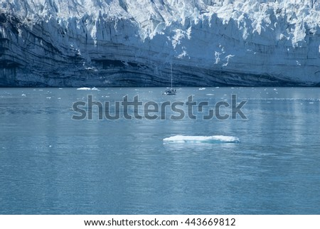 Sailing yacht in front of the Margerie Glacier at Glacier Bay, Alaska - stock photo