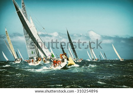Sailing yacht in the regatta. Toned image and blur. Retro style postcard. Sailing. Yachting. - stock photo