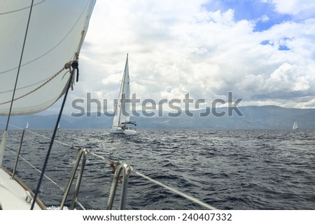 Sailing yacht on the race in a stormy sea. - stock photo