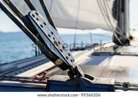 Sailing yacht rigging equipment: main sheet traveller block closeup - stock photo