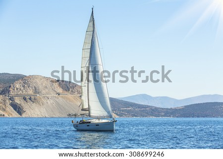 Sailing. Yacht sails with beautiful sky. Luxury yacht.  - stock photo