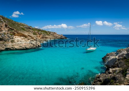 Sailing yacht stay in dream bay with turquoise transparent water. Mallorca island, Spain - stock photo