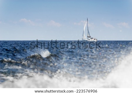 Sailing yacht with white sails. - stock photo