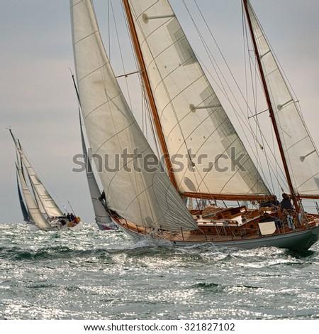 Sailing yachts regatta. Series yachts and ships. Yachting. Sail. Race - stock photo