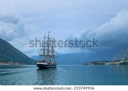 Sailing yaht in the Kotor bay, Montenegro, Adriatic sea - stock photo