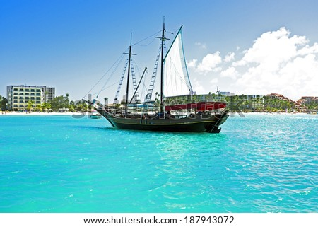 Sailingboat anchoring in the Caribbean - stock photo