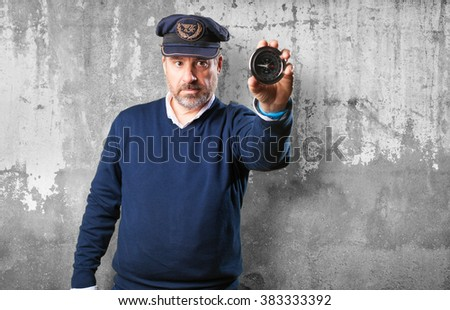 sailor holding a compass