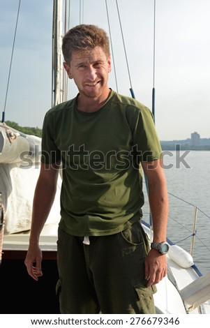 Sailor returns to the marina after a long journey - stock photo