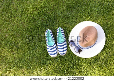 sailor style fashion accessories on green grass with copy space - stock photo