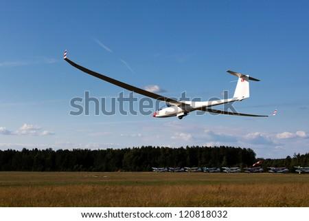 Sailplane DUO DISCUS on final glide, Europe soaring sport championship in Pociunai near Kaunas, Lithuania - stock photo