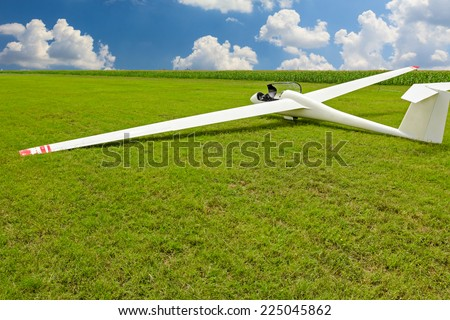 Sailplane, glider airplane wide angle shot on the ground field waiting for take-off. - stock photo