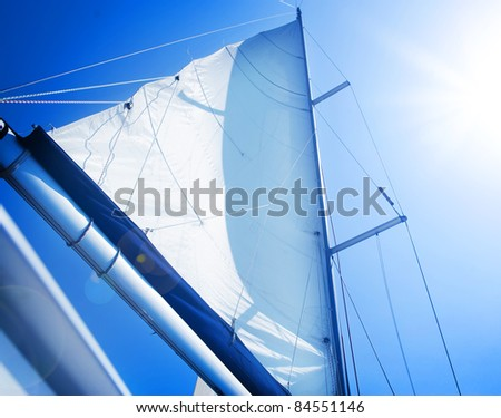 Sails over blue Sky. Yachting concept.Sailboat