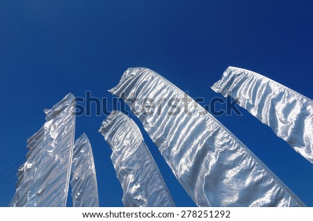 sails with blue sky in summer - stock photo