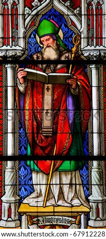 Saint Ambrose, one of the six Latin Church Fathers, on a stained glass church window in the Dom of Cologne