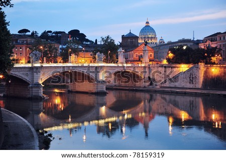Saint Angelo Bridge and Basilica of St. Peter water reflection in the Tiber river at night with the Vatican city in the background in Rome, Italy - stock photo