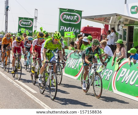 SAINT AOUSTRILLE,FRANCE- JUL 12:Thomas Voeckler and Moreno Moser in front of a delayed peloton at the intermediate sprint line during the stage 13 of Le Tour de France 2013 in Saint-Aoustrille,France. - stock photo
