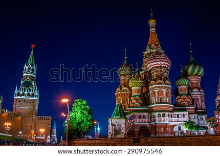 Saint Basil Cathedral on Red Square at night with Kremlin wall and Tower. One of the most popular landmark in Russia. The building is shaped as a flame of a bonfire rising into the sky. - stock photo