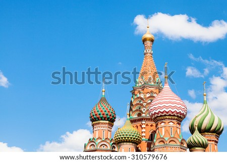 Saint Basil cathedral on Red Square in Moscow and blue sky with white clouds in sunny summer day - stock photo