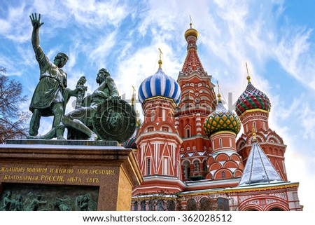 Saint Basil's Cathedral and monument to Minin and Pozharsky on Red Square in winter in Moscow, Russia. Inscription on the monument: Citizen Minin and Prince Pozharsky from grateful Russia, 1818 year - stock photo