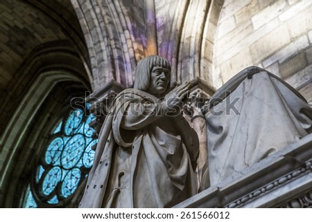 SAINT-DENIS, FRANCE -FEBRUARY 12, 2015 : Recumbent statue of  king Louis XII,  in basilica of saint-denis,  necropolis of french monarchs, February, 12, 2015 in Saint-Denis, near Paris, France. - stock photo