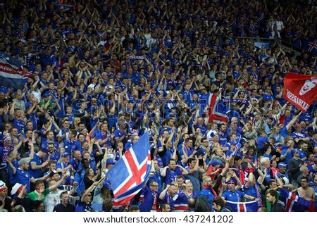 SAINT ETIENNE- FRANCE,JUNE 2016:fans and supporterson the stands in football match  of Euro 2016 in France between Portugal vs Iceland at the stade geoffroy guichard on June 14, 2016 in Saint Etienne  - stock photo