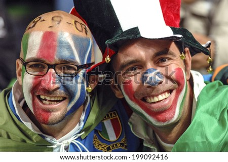 SAINT ETIENNE, FRANCE-SEPTEMBER 30, 2007: italian fans with national flag masked face, during the Rugby World Cup match Italy vs Scotland, in Saint Etienne.