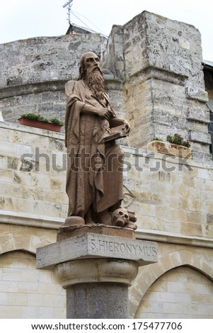 Saint Hieronymus in front of Bethlehem's Church of the Nativity. - stock photo