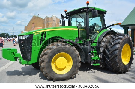 SAINT HYACINTHE QC CANADA JULY 25 2015:Tractor John Deere 8345 R. Deere & Company, the firm founded by John Deere, began to expand its range of equipment to include the tractor business in 1876 - stock photo