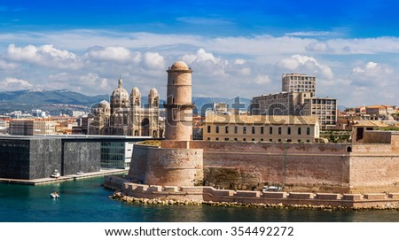 Saint Jean Castle and Cathedral de la Major and the Vieux port in Marseille, France in a summer day - stock photo